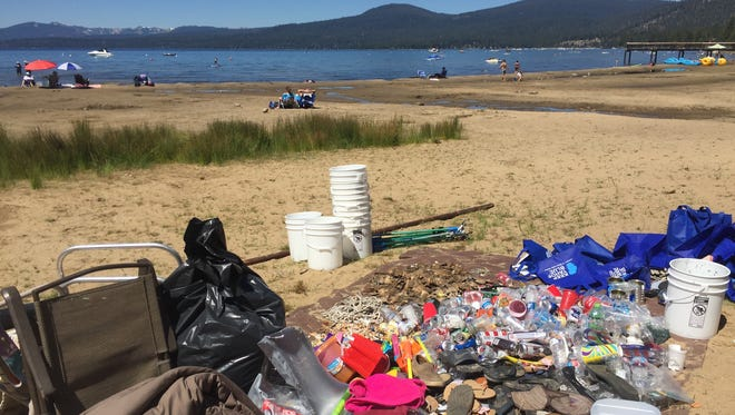 A collection of trash is piled near the shores of Lake Tahoe on Tuesday following a post-holiday beach cleanup organized by the League to Save Lake Tahoe. A collection of trash near Lake Tahoe as seen on July 5, 2016, following a post-holiday beach cleanup organized by the League to Save Lake Tahoe, an environmental group.