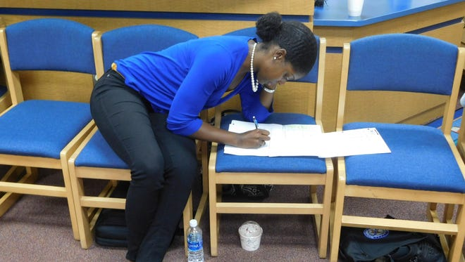 First year teacher Tiffany McClary Lockwood working on a poem.