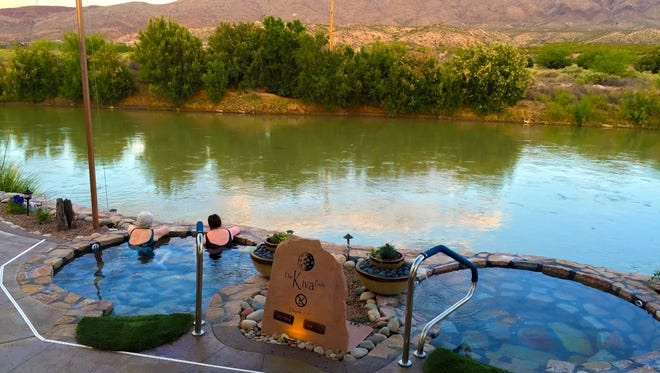 Customers look out at the Rio Grande River as they relax in the Kiva Pools at Riverbend Hot Springs in Truth or Consequences, New Mexico.
