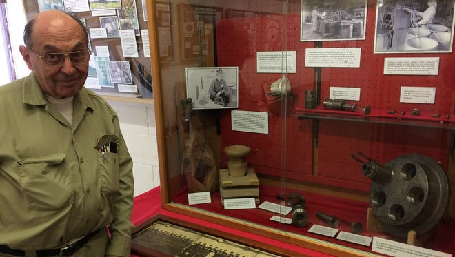 Verlyn Mueller, curator and archivist at the Badger Army Ammunition Plant Museum in North Freedom, shows off an exhibit illustrating how munitions propellant was made at the former factory during World War II, Korea and Vietnam.