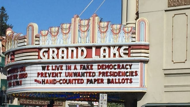 A marquee at the Grand Lake Theater in Oakland, Calif. The theater frequently posts pointed political and social commentary. This one concerned the possibility that the U.S. election might have been hacked, which election experts say can be prevented by vote auditing and the use of paper ballots.