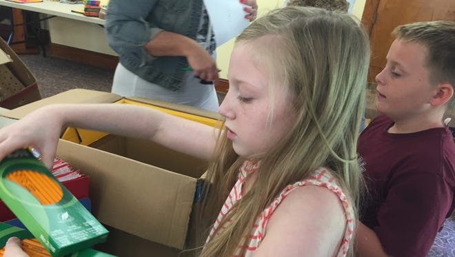 Victoria Arvidson, 11, gathers school supplies to fill a school's order at Naomi Makemie Presbyterian Church in Onancock, Virginia on Wednesday, Aug. 30, 2017. The Eastern Shore of Virginia's four Presbyterian churches donated $3,800 of school supplies for needy students to seven area schools and the Eastern Shore Coalition Against Domestic Violence.