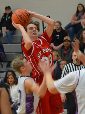 St. Philip's Brodie Landstra goes up for a shot in a win against Athens on Friday.