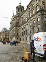 FedEx, the largest employer in the Memphis area, acquired TNT Express and a major foothold in Europe. Here, FedEx makes deliveries in Amsterdam. (photo courtesy of FedEx)