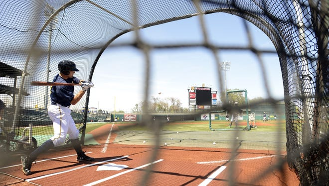 Biscuits catcher Curt Casali participates in batting practice  at Riverwalk Stadium on Monday, March 31, 2014.