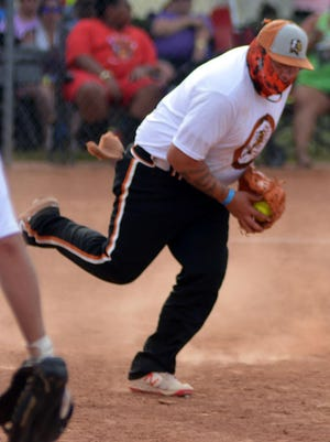Kansas City Indios pitcher Adan Garcia fields a ball from play in the championships against the Big Eagle Express.