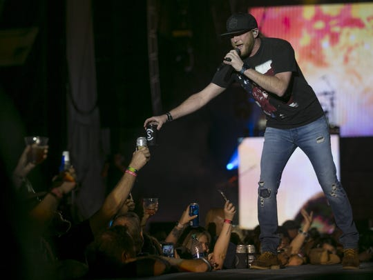 Cole Swindell performs on the main stage at Country