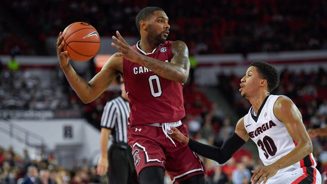 Jan 4, 2017; Athens, GA, USA; South Carolina Gamecocks guard Sindarius Thornwell (0) controls the ball in front of Georgia Bulldogs guard J.J. Frazier (30) during the first half at Stegeman Coliseum. Mandatory Credit: Dale Zanine-USA TODAY Sports