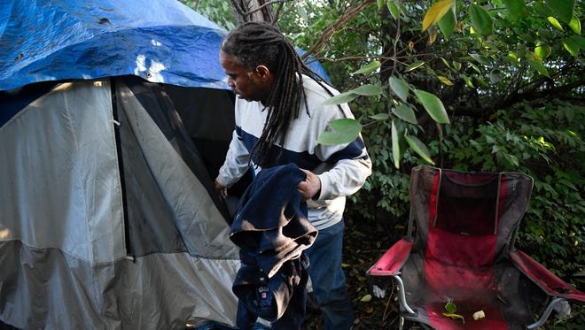 Howard Allen visits his campsite Monday, Oct. 23, 2017, in Nashville. Allen also advocates for other homeless people in the city.