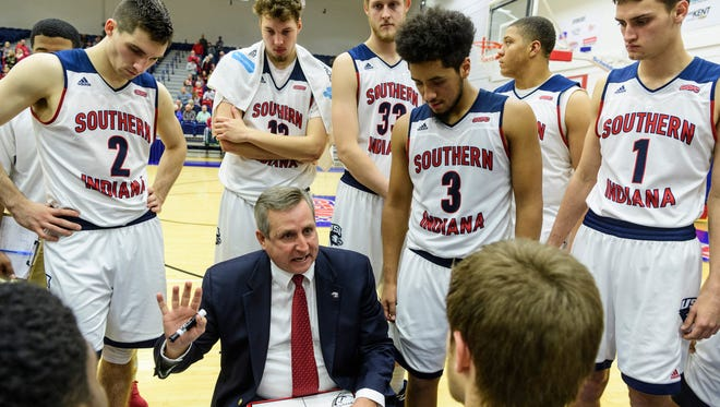 USI Head Coach Rodney Watson talks to his team during a timeout during the second half against the Lewis University Flyers. After going into overtime, the Screaming Eagles defeated the Flyers, 84-75.