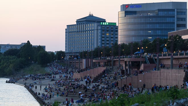 People find seats at Dress Plaza on the Ohio River, in Downtown Evansville, Ind., before the start of the fireworks show on July 4.