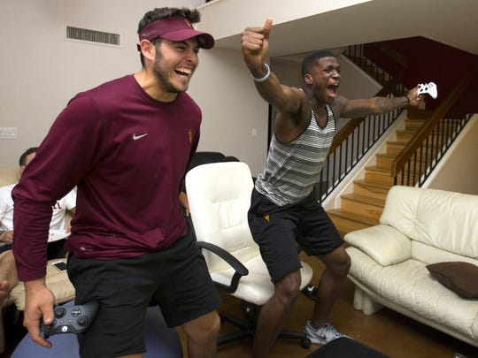 ASU football players Mike Bercovici (left) and Ellis