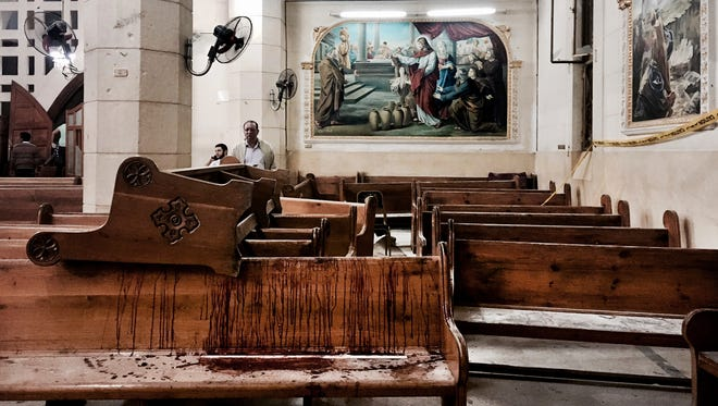 Blood stains pews inside the St. George Church after a suicide bombing in Tanta, Egypt, on April 9, 2017. The Palm Sunday deadly bombings of two churches left Egyptian President Abdel Fattah el-Sisi grappling with the question of how to defeat a tenacious insurgency by Islamic State group militants.