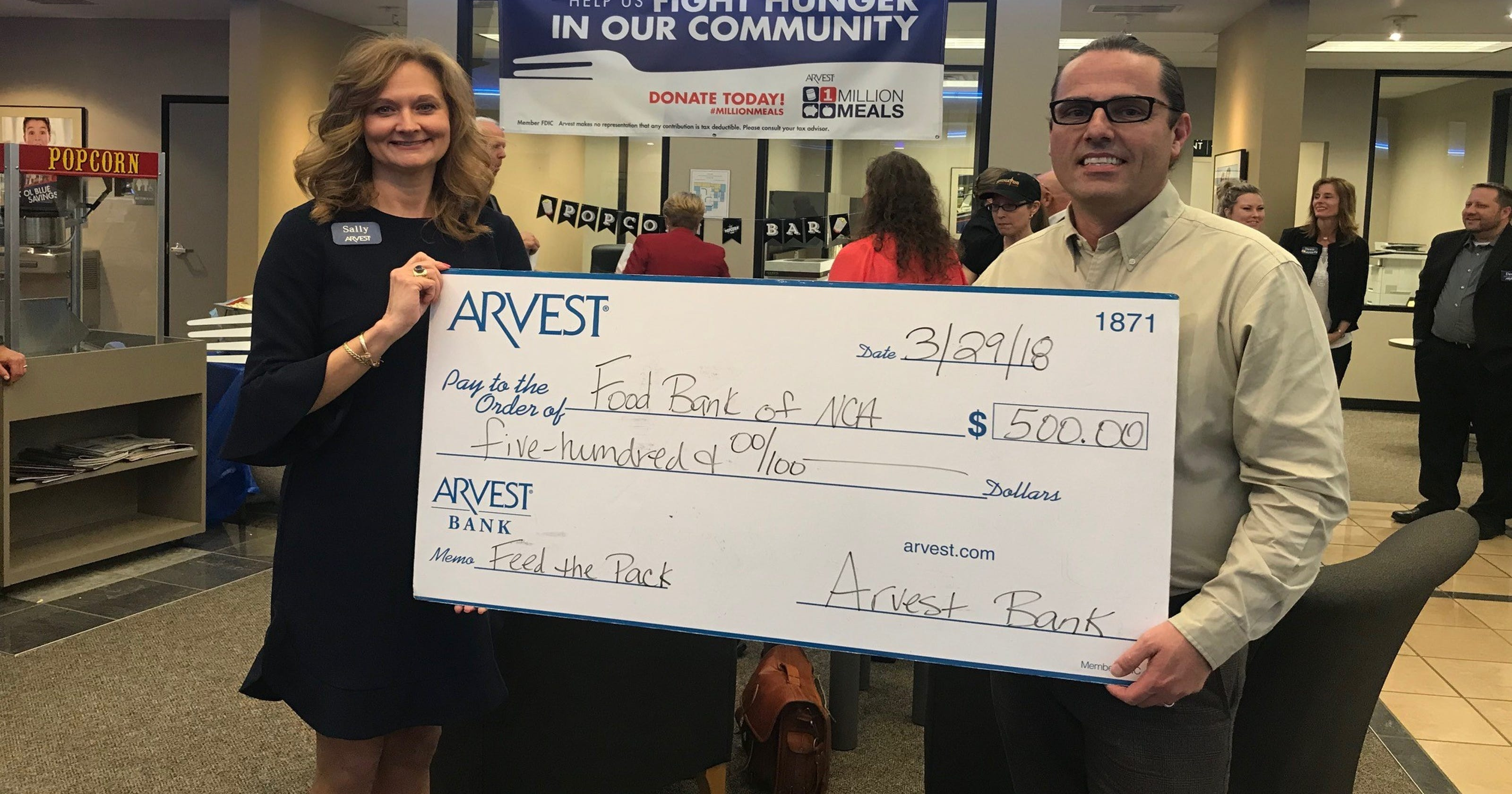 Arvest Bank makes donation to Food Bank of NCA