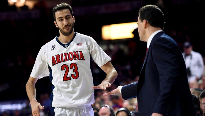 Jan 16, 2016: Arizona Wildcats head coach Sean Miller high fives forward Mark Tollefsen (23) as he comes out of the game during the second half against the Washington State Cougars at McKale Center. Arizona won 90-66.