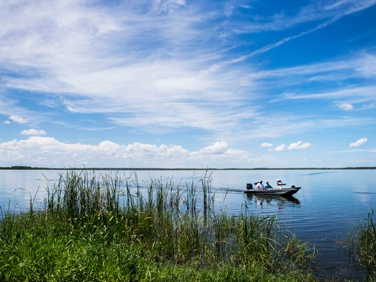 Homer Brown and Tom Moorman make their way to the dock after fishing for crappie on Lake Trafford in Immokalee on Thursday, July 27, 2017.