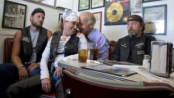 Vice President Joe Biden's talks to customers during a stop at Cruisers Diner, Sunday, Sept. 9, 2012, in Seaman, Ohio.