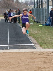 Taylor Wilsey jumps into the sand for the long jump