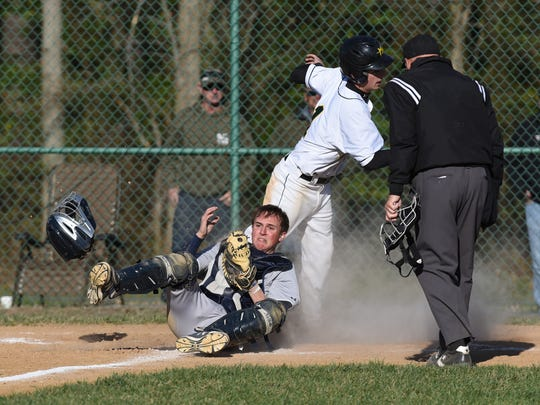 Pocomoke Catcher Jared Hancock holds on to the ball