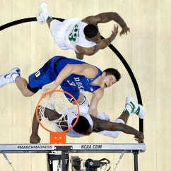 Oregon Ducks forward Jordan Bell (1) blocks a shot against Duke Blue Devils guard Grayson Allen (3) during the second half of the semifinal game in the West regional of the NCAA Tournament at Honda Center.