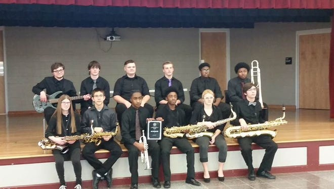 Posing are 2016-2017 Westside High School 806 Jazz Band members from left to right in row one: Ashley Moody (tenor sax), Andrew Meers (alto sax), Tyleek Clinkscales (trumpet), Sincere Hatten (alto sax), Ashley Meers (tenor sax), and James Glymph (baritone sax); and in row two from left are Thomas Brown (bass guitarist), Scott Edwards (piano), GJ Ines (drums), Logan Jermon (drums), Tah'J Hood (vibraphone), and Nevin Belcher (trombone).