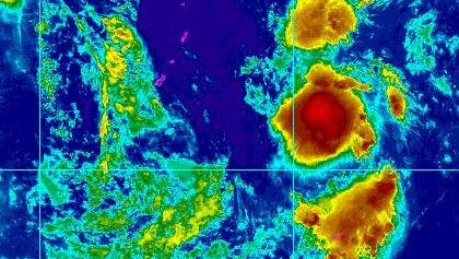 An enhanced satellite image shows the tropical depression to the east of the Marianas Friday.