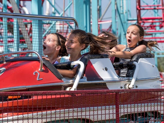 Ron Holman's photograph of Brooke Dougherty, left, Hannah Viera, Bella Zabaleta and Ava Valadao at the Tulare County Fair was recognized as the best feature photo in the 2017 California Journalism Award Contest.