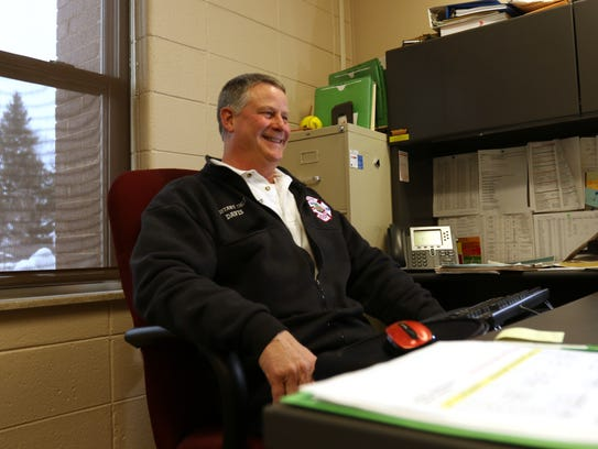 Assistant Fire Chief Jeff Davis laughs in his office