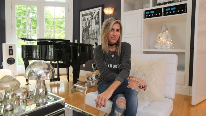 Homeowner Maria Reich is pictured in the living room of her Upper Nyack home for sale, that used to belong to The Allman Brothers Band's longtime guitarist Warren Haynes, photographed May 17, 2016.