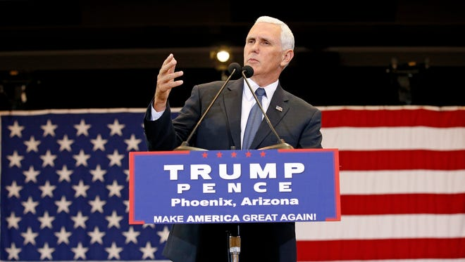 Republican vice presidential nominee Mike Pence speaks at a campaign rally Tuesday, Aug. 2, 2016, in Phoenix.