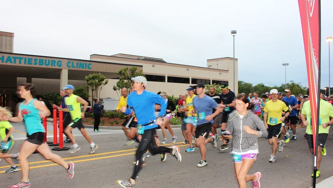 Runners take off on the race route at last year's Rise & Shine Half-Marathon & 5K, hosted by Hattiesburg Clinic.