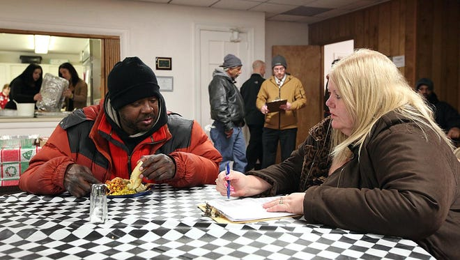 A volunteer conducts a Point-in-Time homeless count survey in New Jersey. Adams County will hold a Point-in-Time count Jan. 27-28.