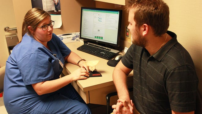 Certified Nurse Practitioner Anne Dugas talks with a patient at Hattiesburg Clinic Urology about prostate function and risk factors for prostate cancer.