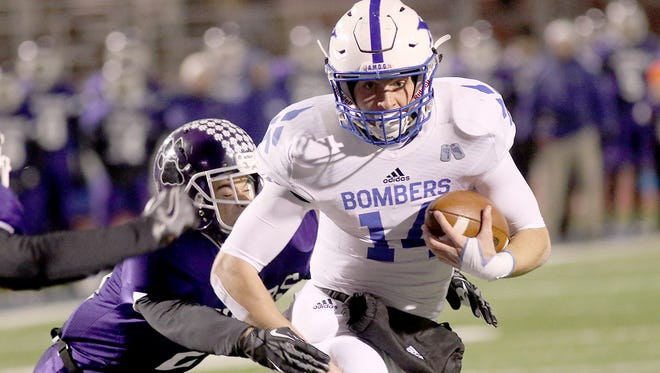 Sean Clifford runs the ball for the Bombers during their football game against Pickerington Central, Friday, Nov. 25, 2016.