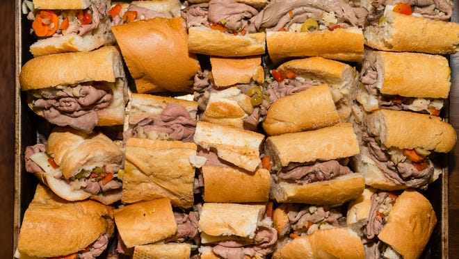 Hot beef sandwiches with spicy giardiniera.