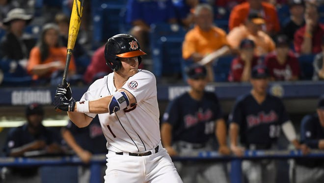 Auburn catcher Blake Logan hit a solo home run vs Ole Miss on Tuesday, May 23, 2017, in Hoover, Ala.