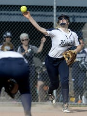 Pittsford Sutherland's Emily Torpey throws to first