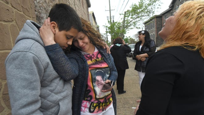 Outside May Funeral Home, family members grieve the shooting death of Jonathan Vazquez, during a viewing for Vazquez' grandmother, Rosa Serrano, on May 5, 2016.  Photo by April Saul