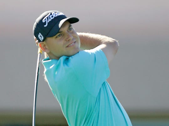 Bill Haas tees off on the 1st hole at the Bob Hope