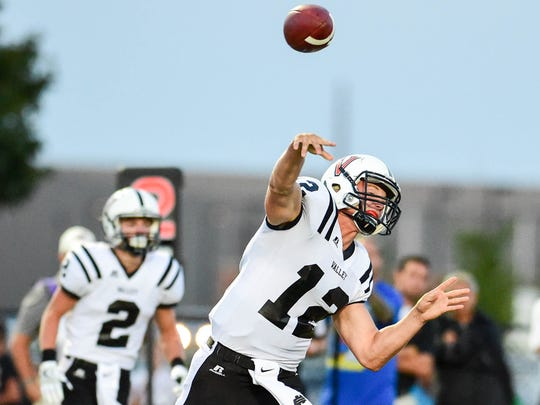 Valley quarterback Rocky Lombardi throw a pass downfield on Sept. 2 against Waukee.