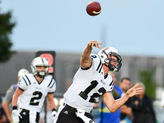 Valley quarterback Rocky Lombardi throw a pass downfield