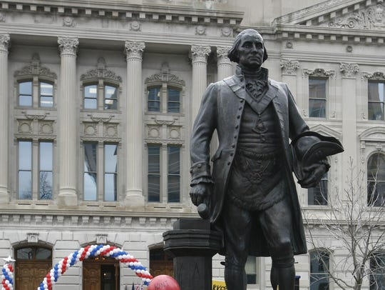 A statue of George Washington gazes out over the crowd