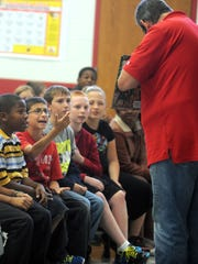 """Seventy volunteers read to Marion City Schools students in grades K-3 Friday as part of the United Way's """"Unity in Community"""" and continuation of its campaign kickoff. It also ties in with the Let's Read 20 initiative, encouraging parents to read with their children 20 minutes per day."""