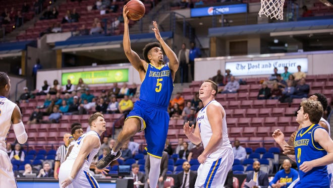 Eric Carter shoots for two in Delaware's CAA Tournament win over Hofstra.