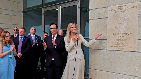 U.S. Treasury Secretary Steve Mnuchin, center left, claps as White House senior adviser Ivanka Trump unveils an inauguration plaque during the opening of the U.S. embassy in Jerusalem on May 14, 2018.