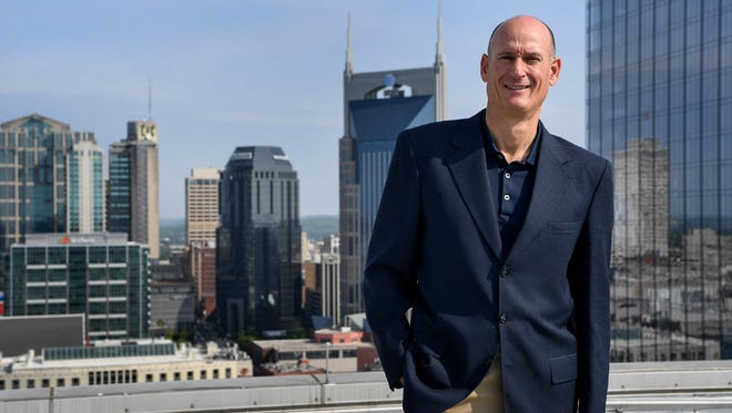 Dan Piotrowski, vice president operations at Omni Hotel, poses for a portrait on the roof overlooking the new construction of hotels around the city in Nashville.