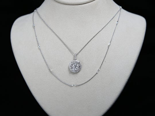 (Top) 2 karat total weight diamond pendant and white gold $6,950 along with a 1.88 karat, marquee diamond necklace for $5325.