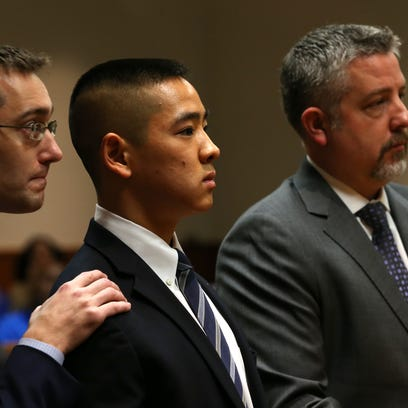 Charles Tan in court with defense lawyers James Nobles