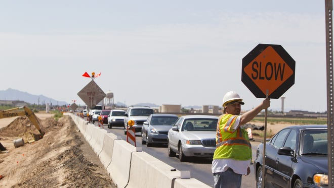 Chris Marko  works on the  Northern Parkway, which is now open in a stretch from Loop 303 east past Litchfield Road. Eventually, the parkway will be limited access parkway to Loop 101.