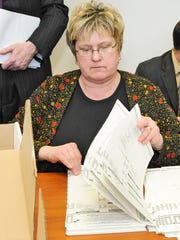 In this file photo, Manitowoc City Clerk Jennifer Hudon goes through absentee ballots during a recent election.